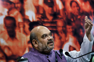 New Delhi: BJP President Amit Shah during a press conference on completion of two years of the Modi government, at party headquarters in New Delhi on Friday. PTI Photo by Subhav Shukla(PTI5_27_2016_000049B)