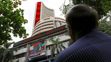 Sensex, Nifty close lower on caution ahead of TCS earnings; Indiabulls Real up 40%