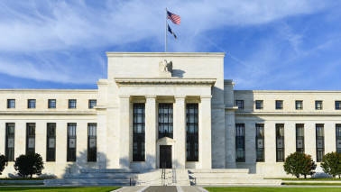 Fed holds rates steady, expects portfolio cuts 'relatively soon'