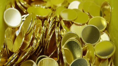 Gold futures slip by Rs 268 on weak global cues