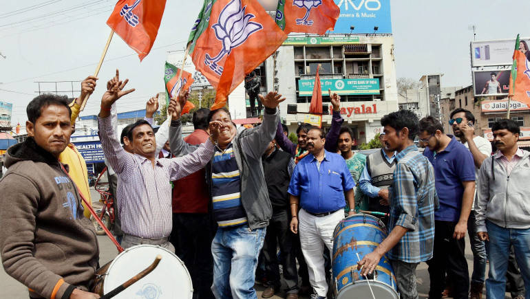 Ranchi: BJP supporters celebrate the party's sweep in Uttar Pradesh and Uttarakhand Assembly elections, in Ranchi on Saturday. PTI Photo
