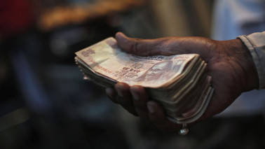 Rupee opens weak at 64.63 per dollar