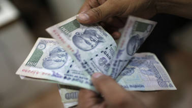 After falling intraday, rupee ends higher at 64.56 as custodian banks sell dollars