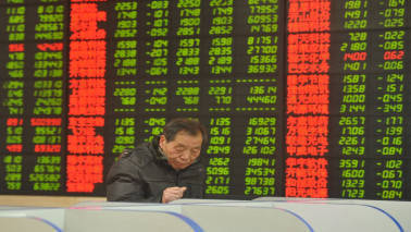 Asian shares shrug off Wall Street gloom, dollar steadies