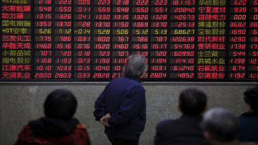 Asian shares mostly lower, dollar weaker; investors eye Korea peninsula, China data