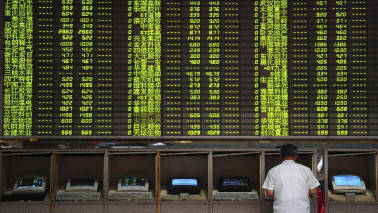 Asian shares edge up, bolstered by modest gains on Wall Street