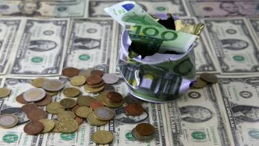 US dollar ends marginally lower against rupee