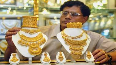 Gold hits more than six-week high as dollar, stocks slip