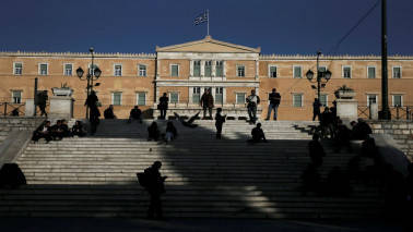 Greece, EU/IMF lenders agree on key labour reforms, pension cuts - sources