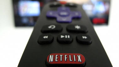 Netflix adds more subscribers than expected, shares hit record
