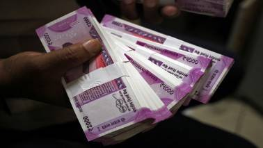 Rupee spurts 37 paise to close at 65.04 against dollar