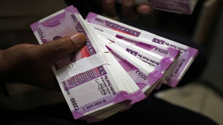 Indian rupee opens weak at 64.34 per dollar; down 19 paise
