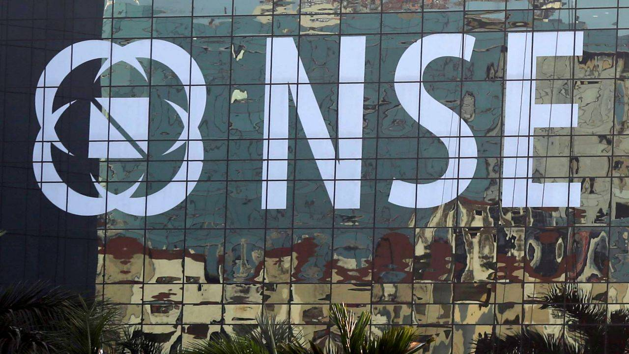 Buildings are reflected on the glass windows of the NSE (National Stock Exchange) building in Mumbai, India, December 27, 2016. Picture taken December 27, 2016. REUTERS/Shailesh Andrade - RTX2WSSZ
