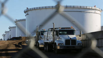 US oil hits two-year high on pipeline outage, lower inventories