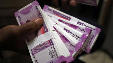 Indian rupee opens at 64.69 per dollar; down 18 paise