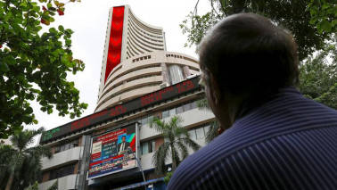 Sensex slips 180 pts, Nifty manages to hold 9500; JP, Adani Groups stocks rally
