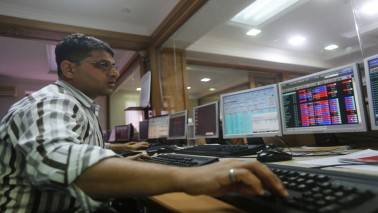 Sensex ends mildly lower, RIL offsets banks' losses; Nifty gains 18% in Samvat 2073