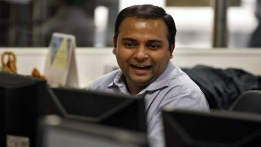 Reliance Industries, IT stocks help Sensex gain 124 pts, Nifty hold 9900; telecom dips