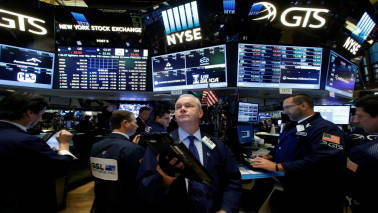 Wall Street slips with healthcare stocks, Nasdaq flat