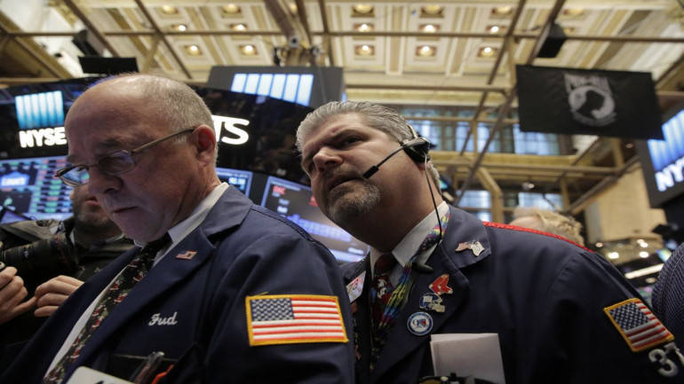 Wall St. slides as investors weigh bank results, global risks