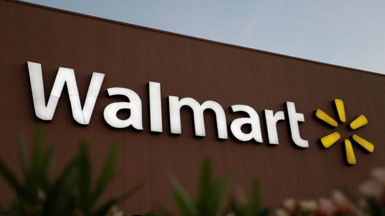 Wal-Mart sees 40% online sales growth next year, shares rise