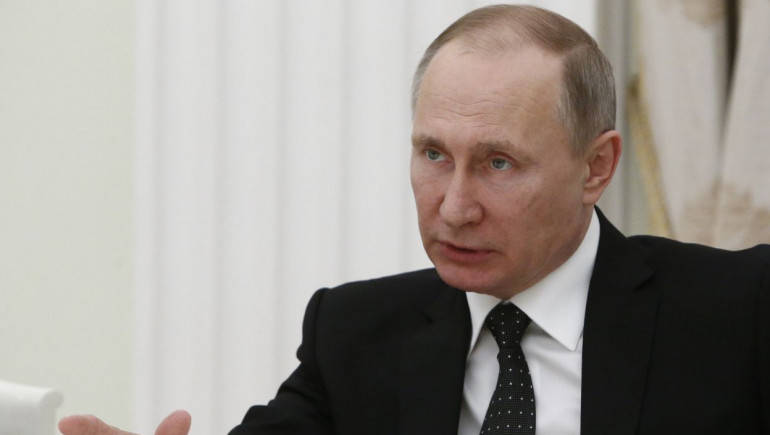 Putin likens U.S. action in Syria to Iraq in 2003