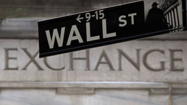 Wall Street ends flat as politics drive stocks