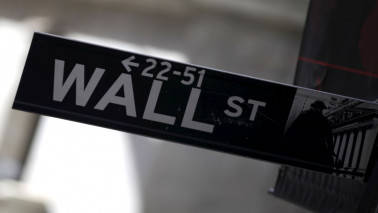 Wall Street ends flat; Netflix jumps after the bell