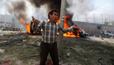 Taliban car bombing at Afghan bank kills 34, wounds dozens