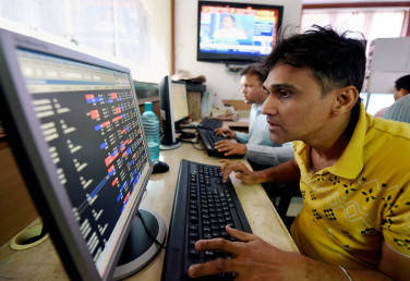 Closing Bell: Sensex ends on a sluggish note, Nifty below 9900; Kotak Bank, Canara Bank fall
