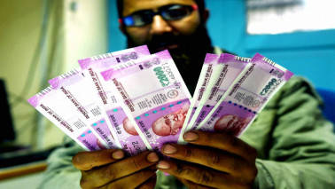 Indian rupee down 13 paise vs dollar in late morning trade