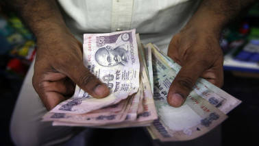 Rupee trades flat at 64.83 in late morning trade