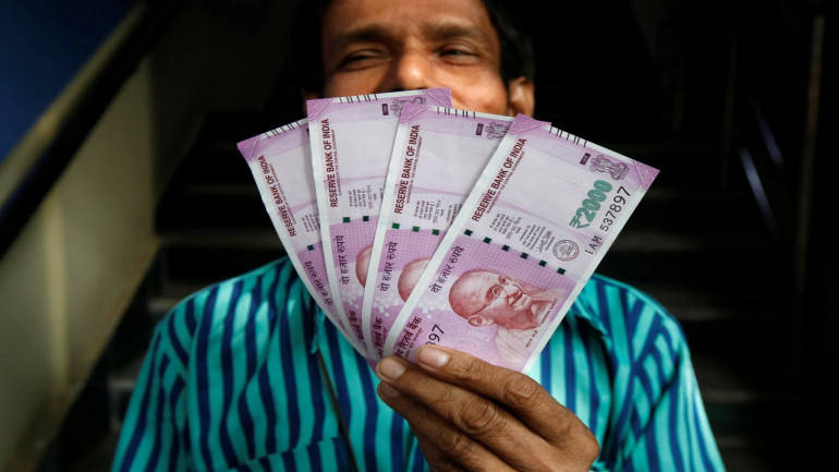 Indian rupee opens at 64.20 per dollar, slips 12 paise