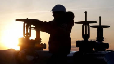 Oil edges up, but still set for biggest H1 fall since 1990s