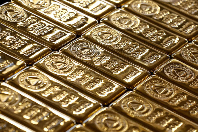 Gold inches higher after five-week low as dollar gains on rate hike views