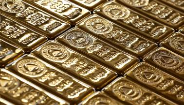 Gold holds above $1,300 but firm dollar weighs