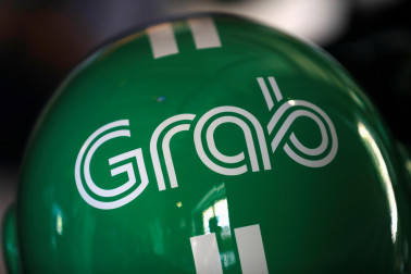 Ride-hailing firm Grab buys India-based payments startup