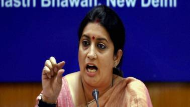 Adopt GST and become part of history : Smriti Irani to biz community