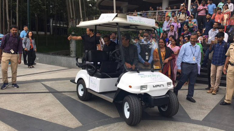 Infosys CEO arrives in a driverless cart, firm to bet big on AI