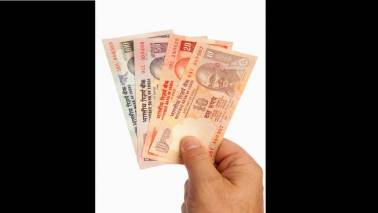 See upward momentum in dollar-rupee continuing, says HSBC