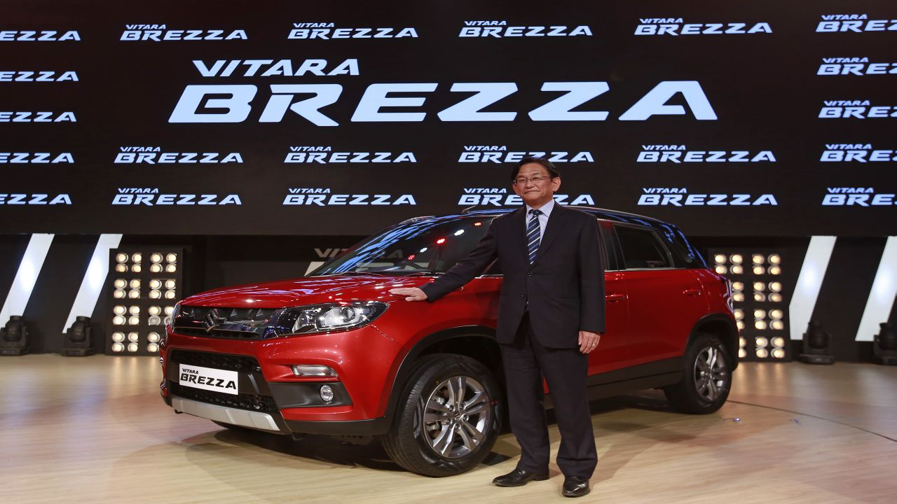 Kenichi Ayukawa, Managing Director and CEO of Maruti Suzuki India Ltd., poses with the newly launched Vitara Brezza car in Mumbai, India, March 8, 2016. REUTERS/Danish Siddiqui - RTS9TEY