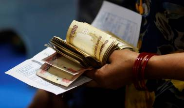 Rupee opens mildly higher at 64.55 against US dollar