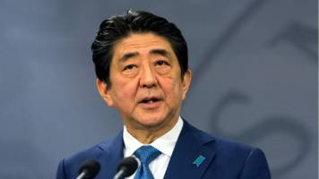 Japan PM Shinzo Abe's ruling bloc on track for big win in election: TV exit polls