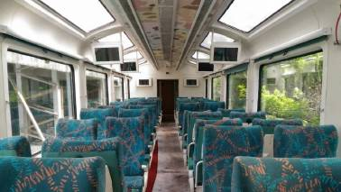 This Mumbai-Goa train compartment has a glass roof, LCD screens and rotating seats