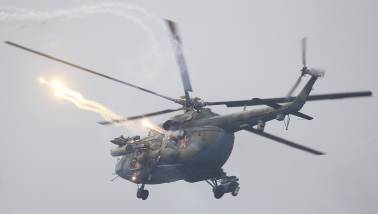 Russian helicopters fire rockets and injure bystanders during military exercise