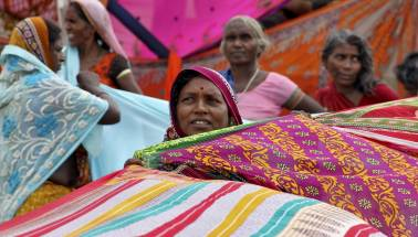 Telangana women fight over, burn free sarees distributed by KCR Government