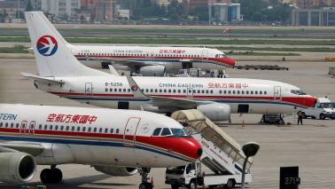 Plane grounded after a woman throws coin into engine for 'luck' in China