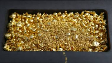 Gold spurts on festive cheer, global cues