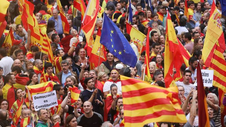 Catalan leader steps back from declaring immediate independence