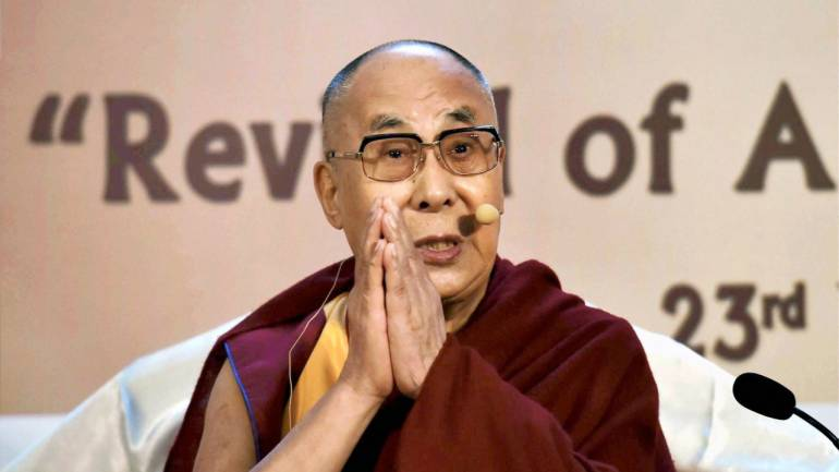 Tibetan spiritual leader Dalai Lama gestures during an interactive session at a city hotel in Kolkata. (PTI)